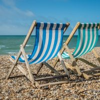 Deck chairs on a pebble beach
